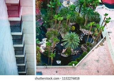 A row of hotel patios looking down from the 25th floor and an aerial view of the tropical pool below.