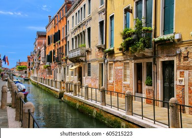Row of houses along narrow canal in Venice, Italy. Venice is situated across a group of 117 small islands that are separated by canals and linked by bridges.