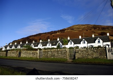 """The row of houses called  the  """"Twelve Apostles"""" at Catacol on the Isle of Arran, Scotland."""