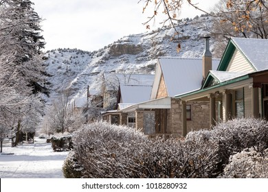 Row of houses covered in snow in downtown Durango, Colorado with Smelter mountain behind