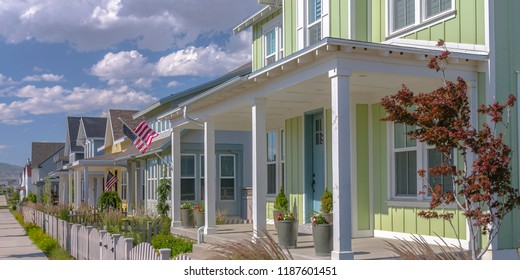 Row of houses with flags in Daybreak Utah