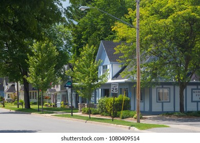 A row of houses on a suburban street in the village of Bellaire in Michigan, United States.