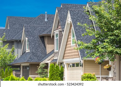 Row of houses on a sunny day with roof and windows