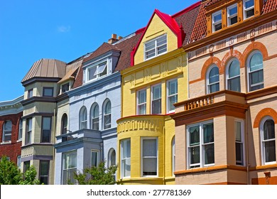 Row houses on a sunny spring day in Washington DC, USA. Historic townhouse architecture of US capital.
