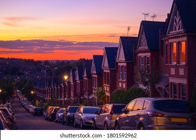 Row of identical English terraced houses at sunset in Crouch End, North London