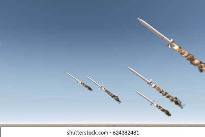 A row of intercontinental ballistic missiles launching in a desert on a blue sky background - 3D render