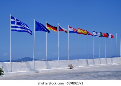 Row of international flags fluttering in Greek port, Greek island of Nisyros, Greece, Europe, July 2017