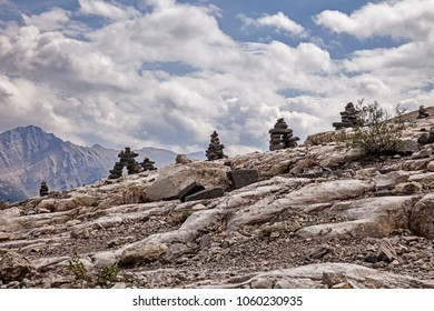 A row of Inukshuk figures line the ridgeline of a portion of the Iceline Trail in Yoho National Park in Canada.