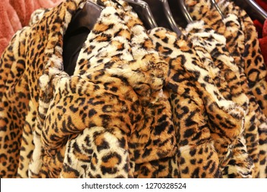row of jackets with leopard pattern in a store, animal print, faux fur