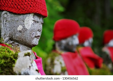 "Row of Japanese ""Jizo"" statues in Kanman-ga-fuchi, Nikko, Japan"