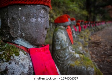 Row of Jizo Bodhisattva or Bake Jizo also known as Ghost Jozi statues at Canmangafuchi abyss in Nikko Japan