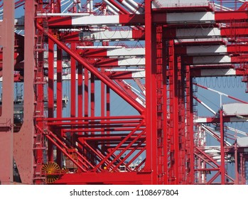 A row of large cranes used for loading containers on to ships