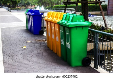 Row of large green wheelie bins for rubbish, recycling and garde