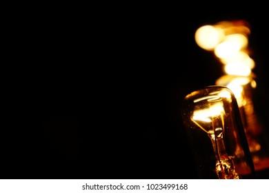 Row of light bulbs. Strip of light bulbs. Series of light bulbs.