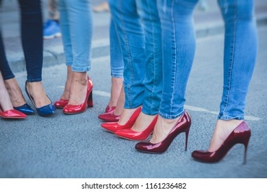 Row line of a legs on high heels in jeans pants during bachelorette party or a birthday, a group of bridesmaids having fun