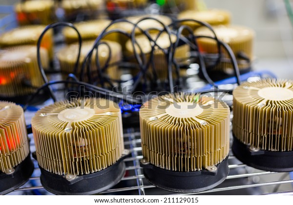 Row of litecoin miners set up on the wired shelfs.