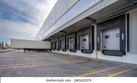 Row of loading docks warehouse building with truck. - Shutterstock ID 1681422574