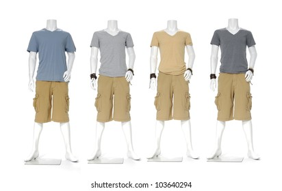 Row of male mannequin dressed in t- shirt with short pants on white background