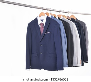 Row of man suit ,Shirts with ties on hangers-white background