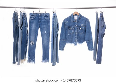 Row of many blue, torn jeans ,jeans jacket hanger