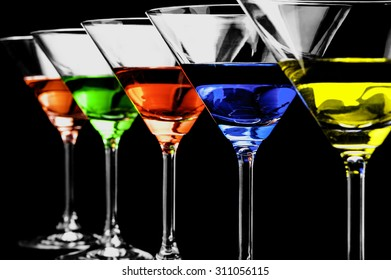Row of martini glasses on a black background in horizontal format