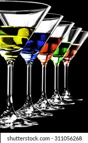 Row of martini glasses on a black background in vertical format