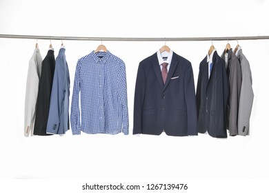 Row of Men's different suits ,Shirts with ties on hangers