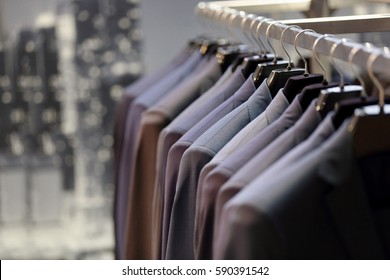Row of men's suits hanging on hanger
