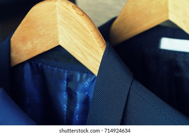 Row of men's suits hanging on rack for sale