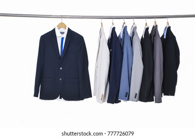 Row of men's suits,tie on hanger-white background