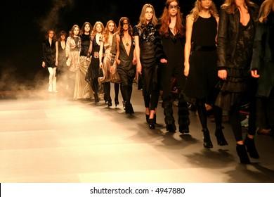 row of models in a runway