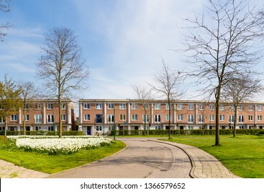 Row of modern brick houses during springtime in a family friendly suburban neighborhood in Houten in the Netherlands.
