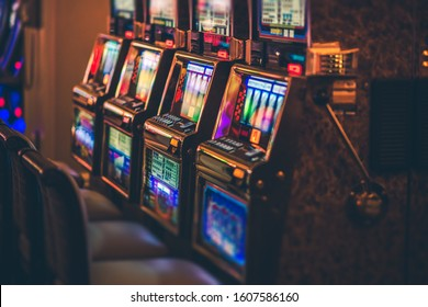 Row of Modern Casino Slot Machines with Shallow Depth of Field. Gambling Industry.