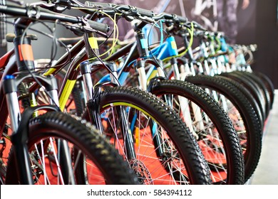 Row modern mountain bikes in sports shop