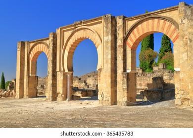 Row of Moorish arches of the Portico inside Medina Azahara (vast, fortified Arab Muslim medieval palace-city) near Cordoba, Andalusia, Spain