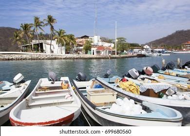The row of motor boats in Bahia de Santa Cruz resort town (Huatulco, Mexico).