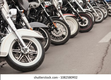 Row of motorcycles parked on a street