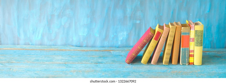 row of multicolored hardback books , panorama, reading education, literature, good copy space