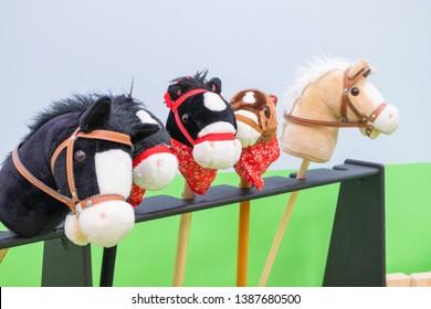 The row of multicolored hobbyhorses - children toys.
