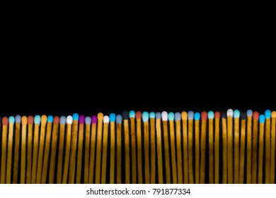 a row of multicolored match sticks