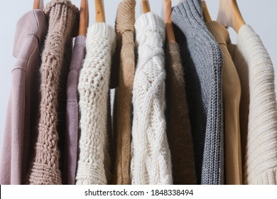 Row of multicolored turtleneck knitwear ,sweater warm cloth on hangers. Fashion concept.