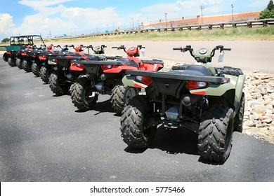 A row of new all-terrain vehicles ready to hit the trails
