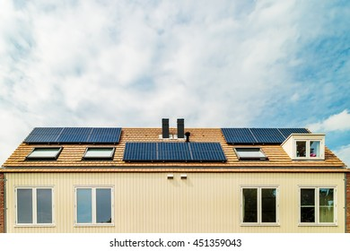 Row of new Dutch houses with solar panels