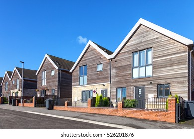 Row of new english houses made from wood