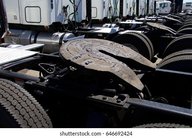 A row of new Heavy Duty Commercial Vehicles at a Dealership. All markings and trademarks have been removed. Westminster, Colorado  05/24/17