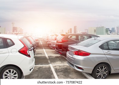 A row of New Japanese cars parked at a car dealership stock