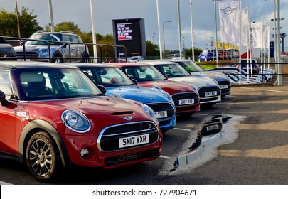 Row of new Mini Cooper cars on forecourt, Seafield Road, Edinburgh. Scotland UK. October 2017