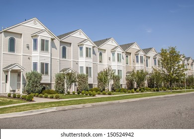 A row of new townhouses or condominiums.