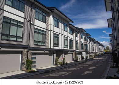 A row of a new townhouses. External facade of a row of colorful modern urban townhouses.brand new houses just after construction on real estate market
