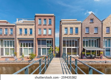 Row of newly build contemporary houses with a bridge in front in The Netherlands